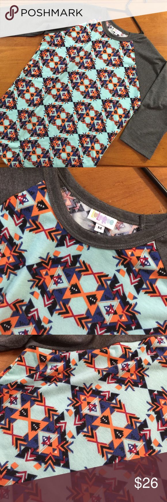 Lularue Randy (?) medium Aztec print Wore this once, in great condition.  3/4 length sleeve. I am not sure this is a Randy but that's what I think I see other people call this style. LuLaRoe Tops Tees - Long Sleeve