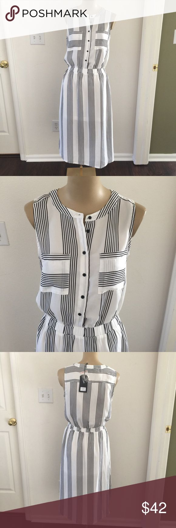 💛 NWT Black and white striped dress NWT black and white striped shirt sleeve dress. Has partial lining for the perfect effect Very J Dresses