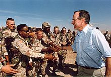 George H. W. Bush visited American troops in Saudi Arabia on Thanksgiving Day. 1990
