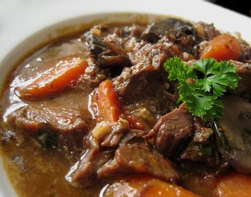 Beef Daube Provençal - This classic French braised beef, red wine, and vegetable stew is simple and delicious. The flavor and texture allow you to keep it warm for your guests. Buy a whole-grain baguette, bagged salad greens, and bottled vinaigrette to round out the meal. Directions to make in slow cooker included.