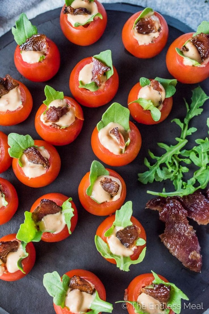 If you're looking for bite-sized appetizers for your next party, look no further. These Mini BLT Cups are as cute as they are delicious! Cherry tomatoes are stuffed with arugula and a little chipotle mayo then topped with a piece of crunchy bacon. They're a healthy gluten-free + paleo + Whole30 appetizer recipe that everyone will love! | theendlessmeal.com