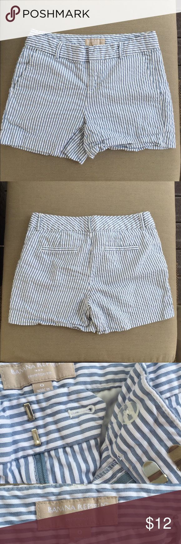 Banana Republic Hampton Seersucker Shorts These shorts are super cute for a summer's day! The front has a hidden zipper and front closing clasp with a button. These shorts have been worn several times so there are signs of wear. Still functional however. I just wish they still fit me :( color is light blue with white pinstripes. Banana Republic Shorts