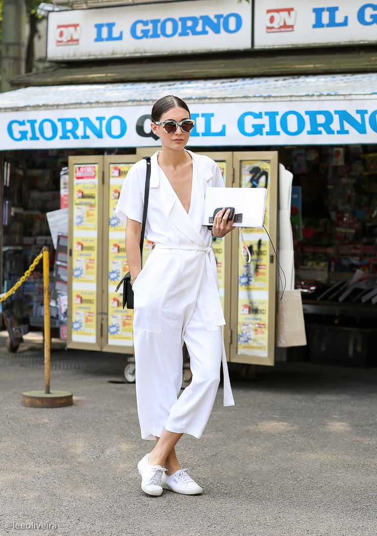 Easy white jumpsuit and comfortable sneakers for all-day wandering / the love assembly