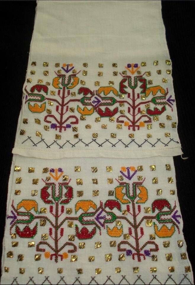 'Uçkur' (sash / waist band) with embroidered ends. Marmara region, mid-20th century. Very stylized floral motifs in 'two-sided embroidery' (front and rear are identical) and small squares in 'tel kırma'-technique (geometrical motives obtained by sticking narrow metallic strips through the fabric and folding them. The motifs are identical on both sides of the fabric).