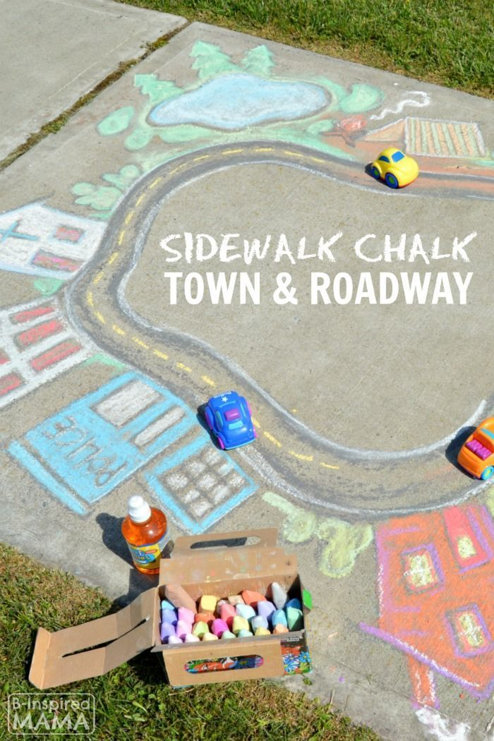 This GIANT sidewalk chalk art town and roadway is easier to make than it looks!  And a fun activity idea - for kids to play in outside in the summer.  Click through to the blog post to find tips and tricks for making a sidewalk chalk road and town for your kids.