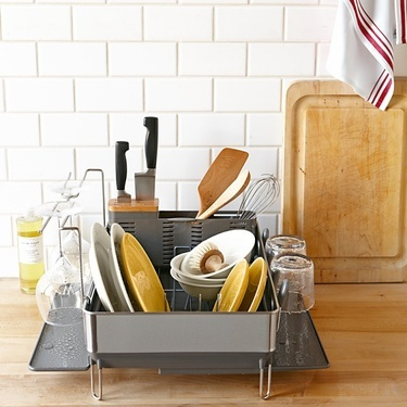 This simplehuman™ steel frame dish rack with wine glass dryer from Williams Sonoma will generously meet your dishwashing needs. - Dwell | At Home in the Modern World: Modern Design & Architecture