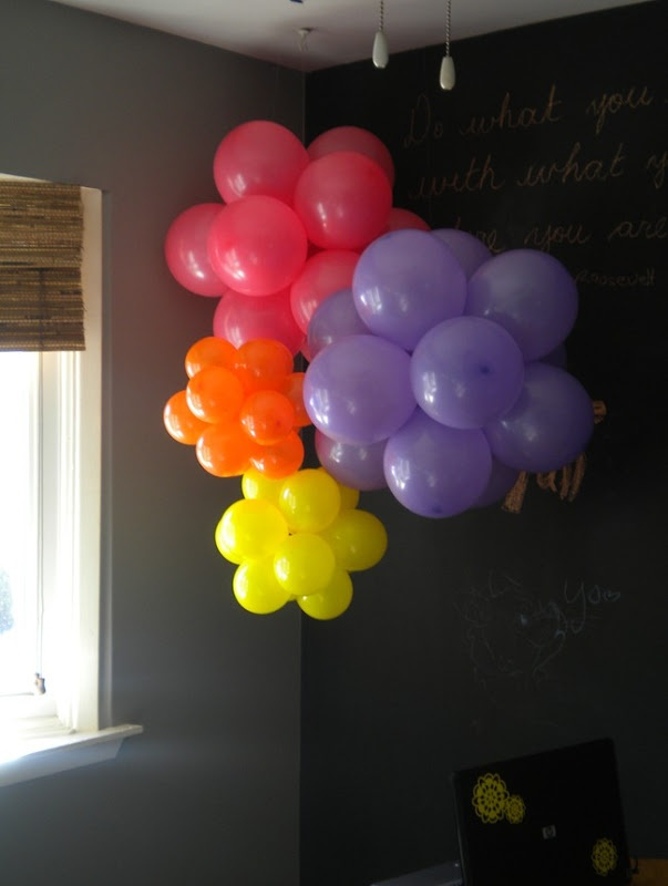 I wouldn't have thought to use a zip tie to join balloons, but it sure does work!  I did this with green balloons for Emery's Dora party to make trees for the forest, as part of the scavenger hunt.  We hung lots of brown streamers from them to make trunks.