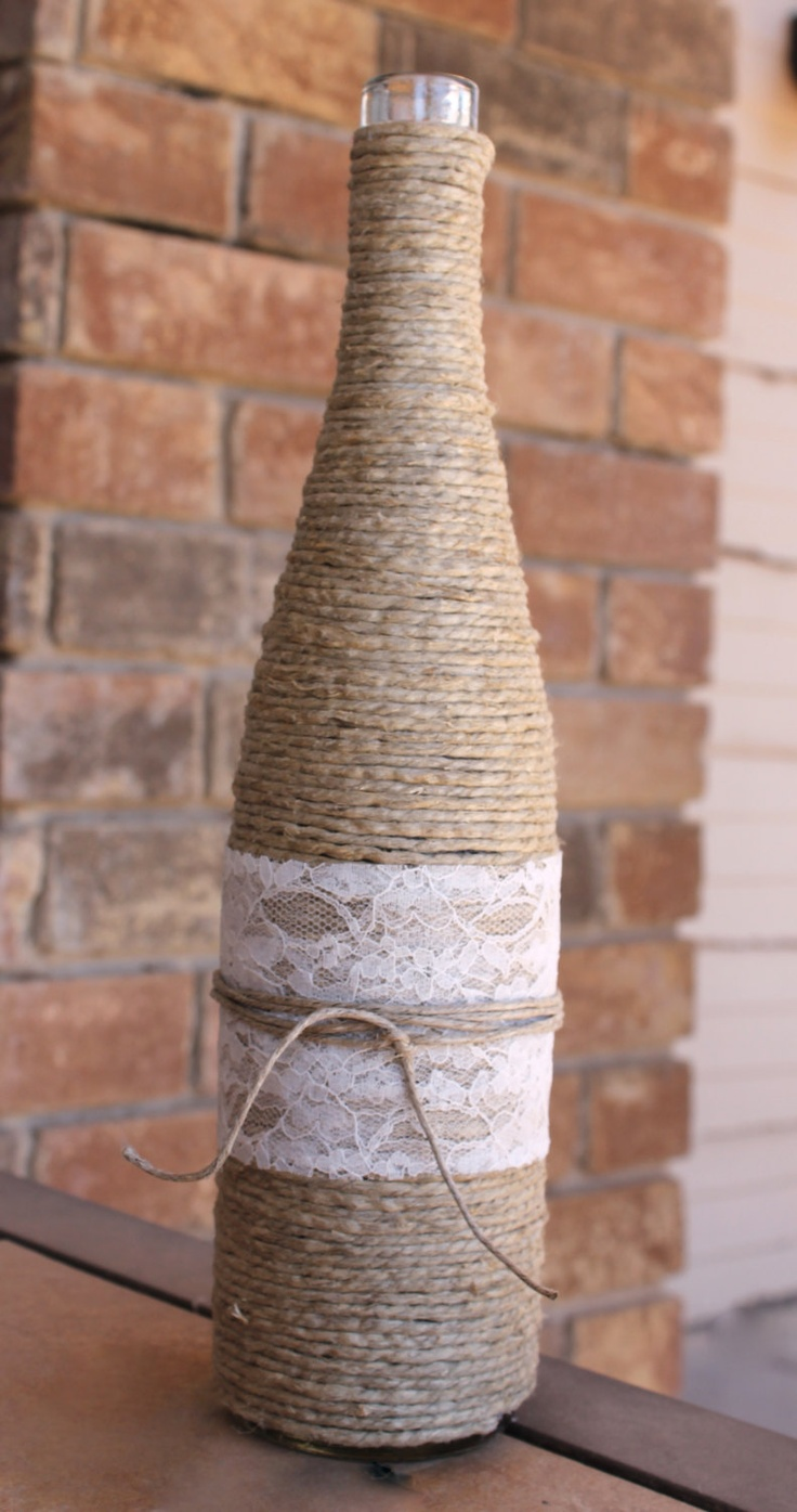 Twine wrapped wine bottle with lace wrap. $12.00, via Etsy.