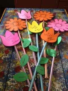 Flowers on Pixie sticks... maybe for Meet the Teacher night? Let's bloom together in 1st grade!