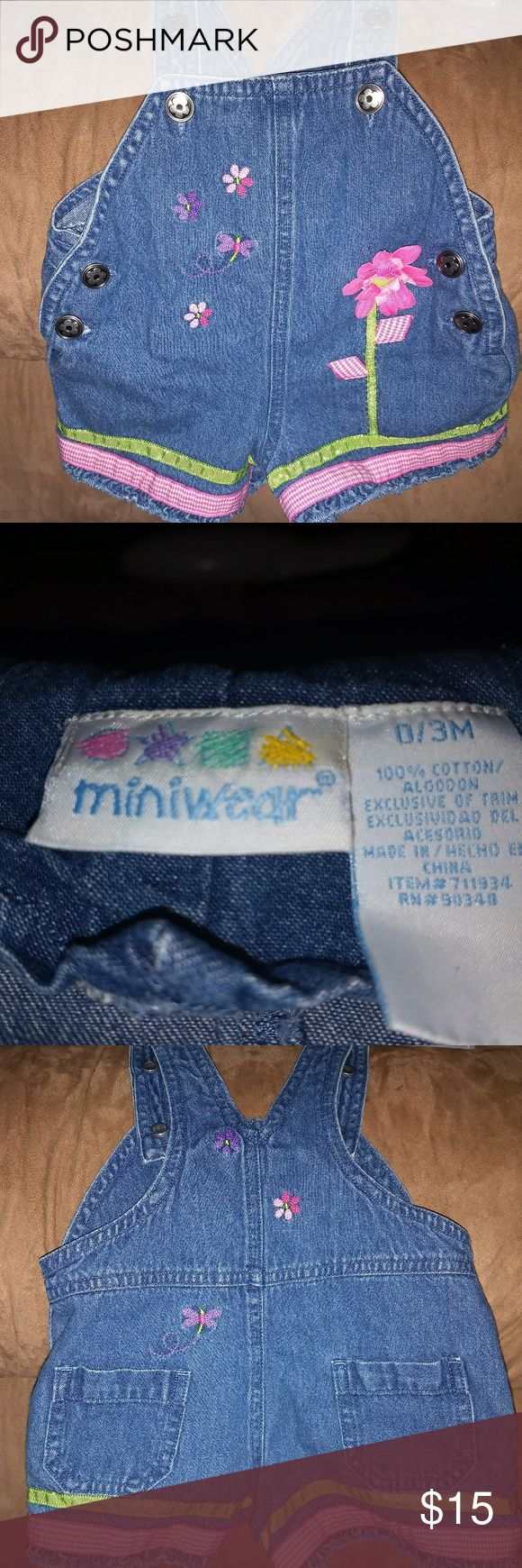 Little girl's short overalls. Adorable little girl's short overalls with flower design on front. Creat condition with no holes or stains. Comes from smoke free home. miniwear One Pieces