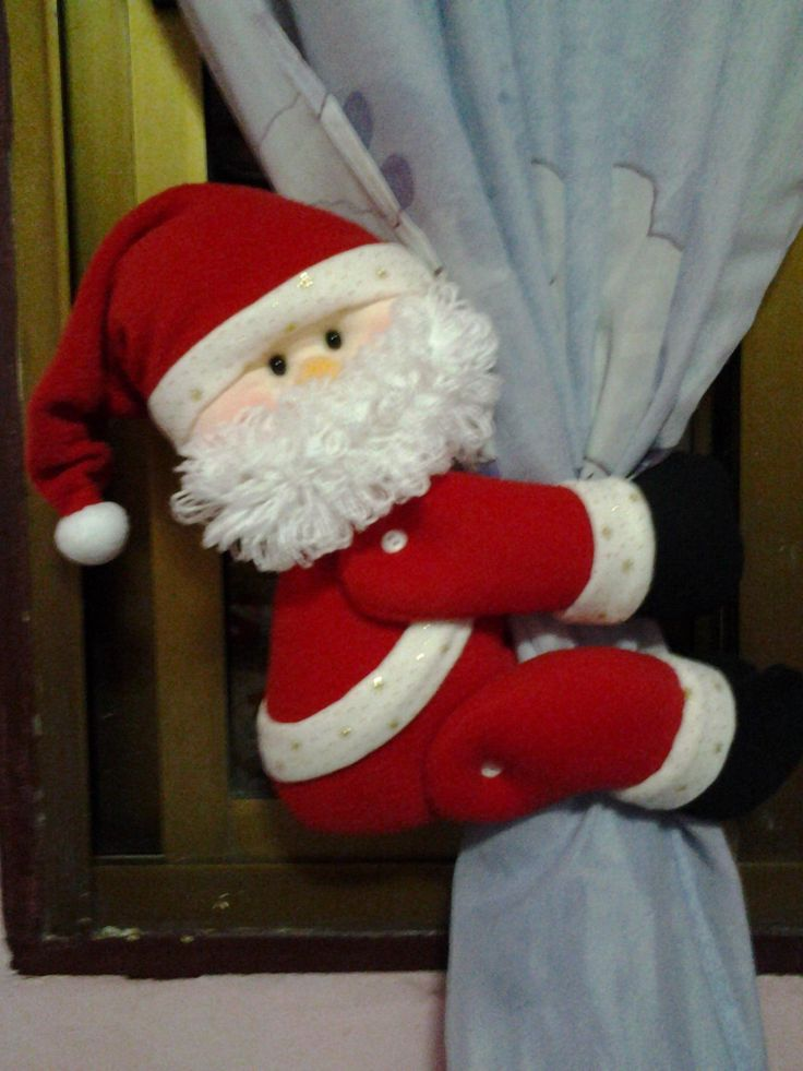 santa holding the curtain