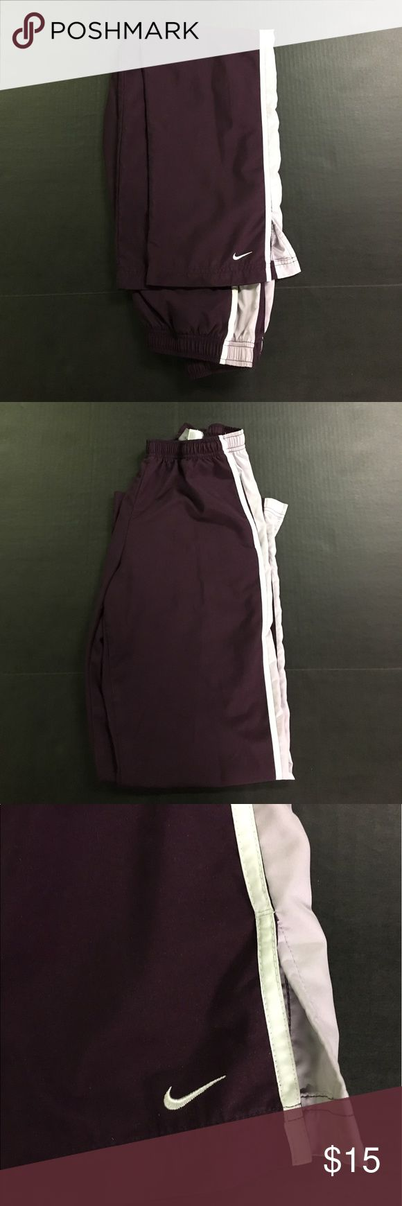 "Pre-owned Women's Purple/White Nike Athletic Pants Item Description: Pre-owned Women's Purple and White Nike Athletic Pants (Size Small 4-6)  Brand: Nike  Material:  Size: Small (4-6) Retail Price: $45 Condition: Clothing may have remnants of prior fragrances from prior use and wear. Authenticity: 100% Guaranteed   Length Dimensions: 39""  Waist Dimensions: 13""  Inseam Dimensions: 28""   Note: Please remember that some of my store items are secondhand clothing meaning used/pre-owned condition…"