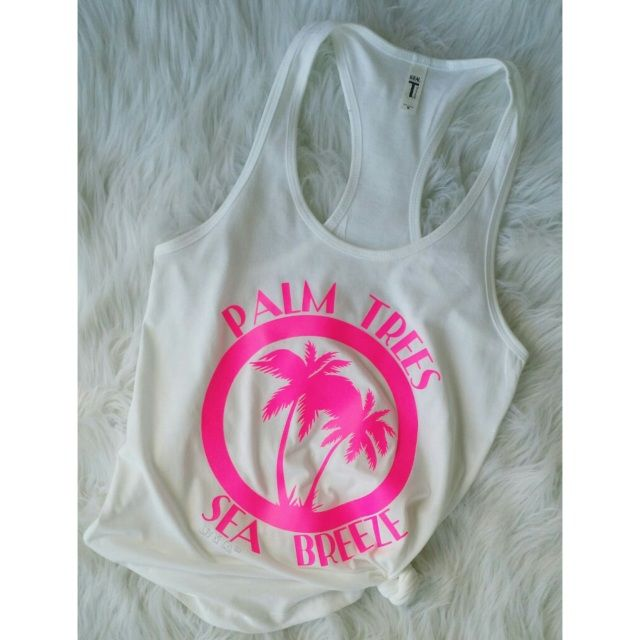 FREE SHIPPING in the USA Palm trees and sea breeze, because that's what the beach is all about!  Our exclusive design is printed on your choice of a cozy cotton tee shirt or 60/40 cotton/poly lightweight racerback jersey tank top.  Several color options available.
