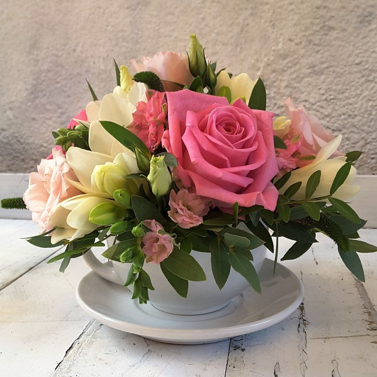 Pink & white floral arrangement in a teacup
