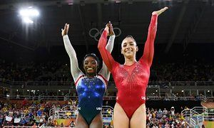 Simone Biles, left, Aly Raisman celebrate winning gold and silver respectively at the women's individual all-around final.