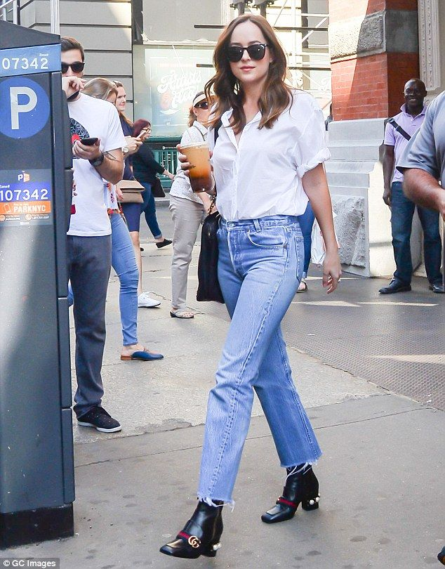 Comfy fit:Dakota Johnson, 27, decided to play it comfortable as she donned baggy jeans and a loose shirt in NYC on Friday