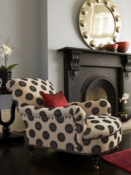 Polka dot chair, black mantle, matte walls. Wow.