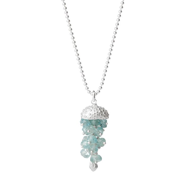 """ADORABLE.  """"Enchanting and unexpected, this elegant recycled sterling silver jellyfish is hand cast from a tiny sea urchin shell and accented by a cluster of 23 tranquil blue topaz stones. Handmade in Hawaii by artist Catherine Weitzman."""""""