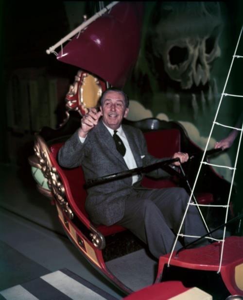 "Walt Disney, taking a ride on the vintage ""Peter Pan"" attraction at Disneyland."