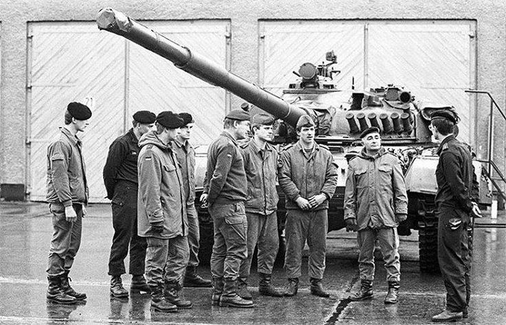 Officer tanker GDR National People's Army holds a lecture on the device of the T-72 for the Bundeswehr officers. 1990.