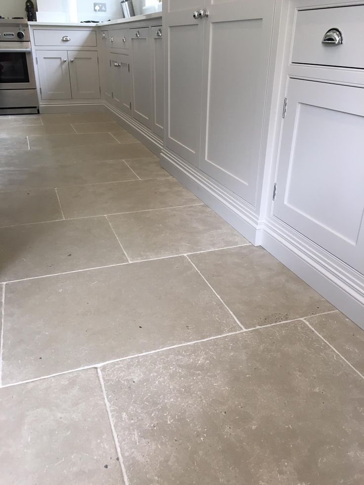 Paris Grey limestone tiles for a durable kitchen floor. Light grey toned interior and exterior stone flooring. Image from residential property in Weybridge Surrey UK. http://www.naturalstoneconsulting.co.uk/limestone-paris-grey-limestone