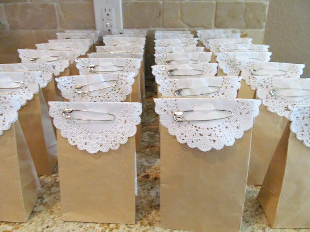 Goodie bags with doilies.  Would look even cuter with a colorful ribbon.