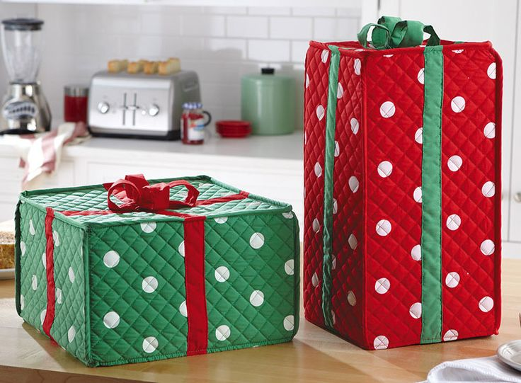 oliday Gift Box Kitchen Appliance Covers. These festive coverings may look like wrapped presents, but they are actually clever disguises for concealing a blender, toaster, coffee maker, and other small appliances. Great solution.