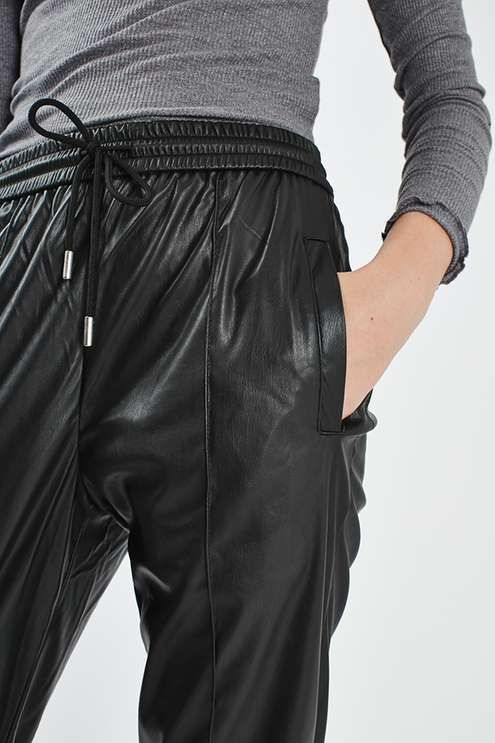 Black faux leather jogger with elasticated waistband and metal end drawcord detail. #Topshop