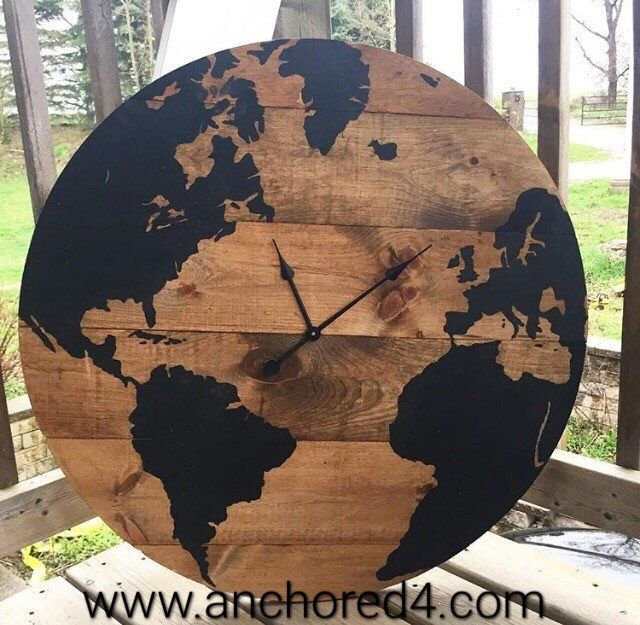 """The World is Yours"" is one of the many beautiful rustic clocks we offer at our online boutique.  www.anchored4.com We ship world wide!!!  Sign up for our free Anchor Rewards Program to earn anchor points to get money off purchases or cash in anchor points to get items in our store FREE!!!"