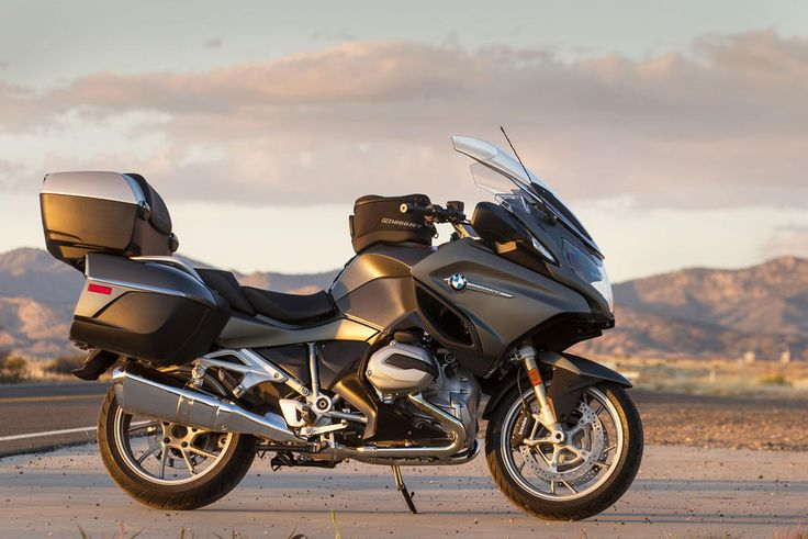 8) Best Sport-Touring Bike: BMW R1200RT (cont.) Because it's 130 lb. lighter than its six-cylinder K1600GT sibling, the R1200RT is more at home on winding roads, yet it still shines as a sporty long-distance tourer with saddlebags, optional top case, and massive fairing that keeps you remarkably dry in the wet. Dynamic ESA, BMW's semi-active suspension, makes two-up touring safer by adapting the R1200RT to any condition.