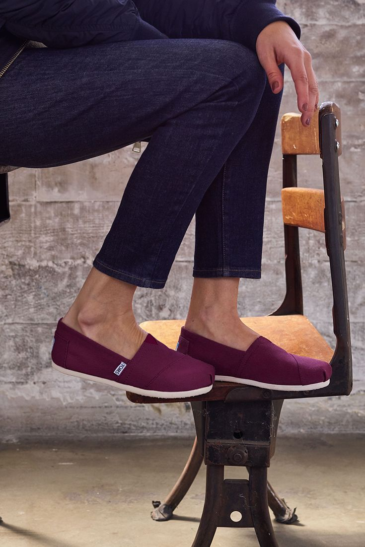 Slip-on shoes in a new hue. Introducing the Red Mahogany Canvas TOMS Classics.