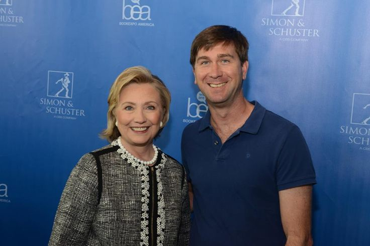 Hillary Clinton has her shot taken with one of the owners of Green Apple Books.