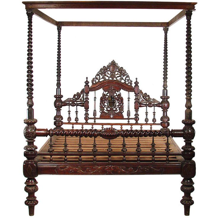 A Mohogany four poster bed w a Barley Sugar twist posts w/ a carved canopy cornice. & there's an angel on the headboard, again, nice.....  1stdibs | Anglo/Indian Mahogany Bed
