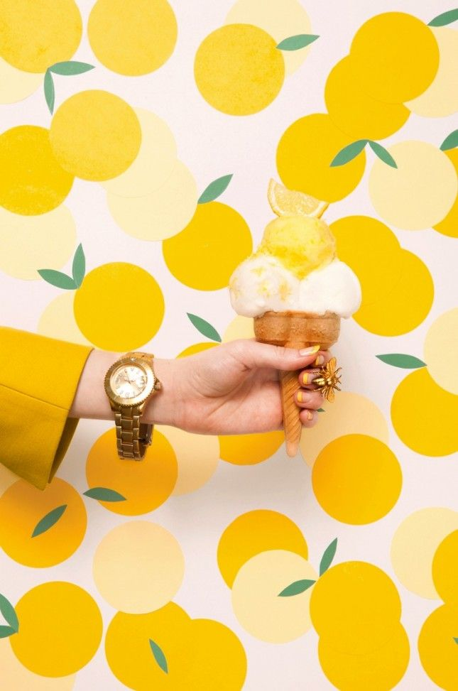 Make springtime last forever in your home with this bright lemon wallpaper.