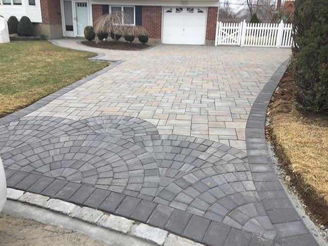 This beautifully designed driveway is just what you need to make your house different than all the rest. This driveway features beautiful Cambridge Pavingstones with ArmorTec. Installation: Flawless Masonry
