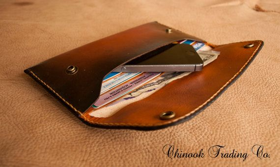 A full grain ,vegetable tanned long wallet for men or women. The wallet has six card pockets plus a cash slot and a slot for your smart phone