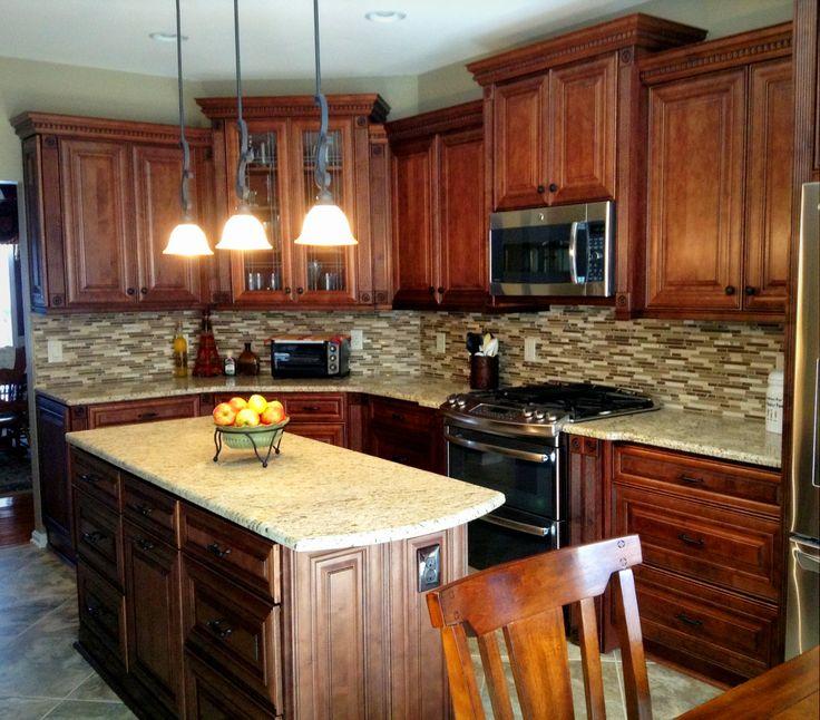 lighting, stainless steel appliances, and porcelain tile flooring