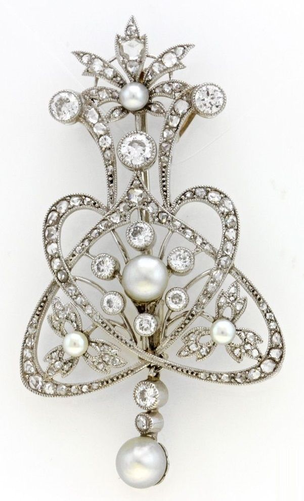 A Belle Epoque platinum, white gold, diamond and pearl brooch. 5 x 3cm…