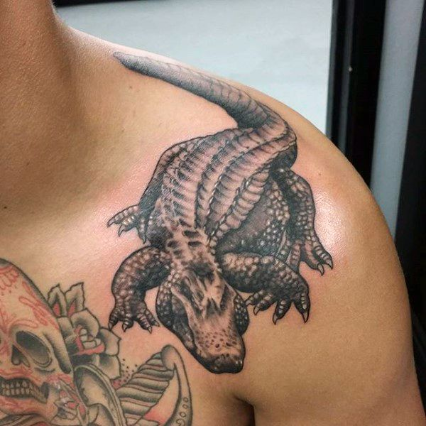 Man With Amazing Black Alligator Tattoo On Shoulders