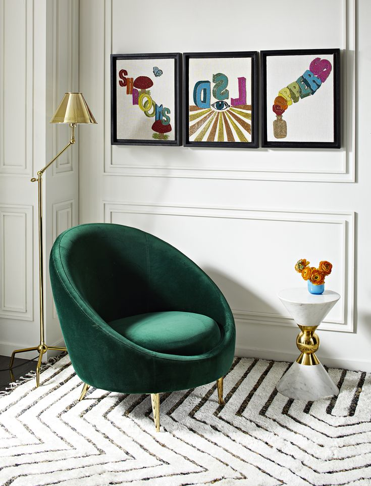 The Jonathan Adler Ether Club Chair in Rialto Emerald (Green Velvet).The Minimalist gesture of the capsule-inspired silhouette provides surprising comfort, while gleaming gold brass stiletto legs project enough posh for a formal parlor/ living room.