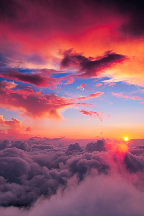 Sunset high above the clouds