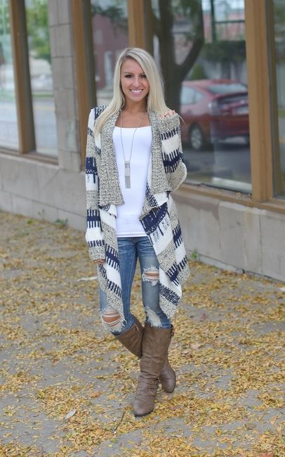 Striped open front cardigan with shawl collar and asymmetrical hem. Navy, tan and white