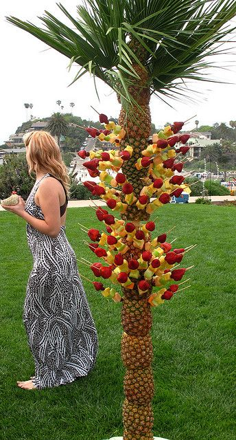 Pineapple Tree with Fruit Skewers. I would probably just use 1 pineapple as a centerpiece.
