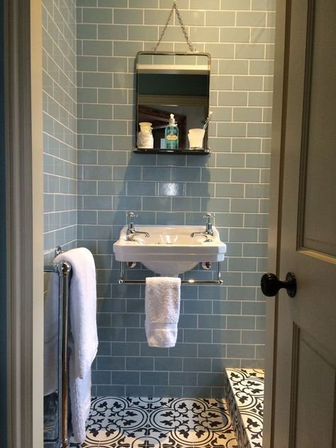 Bedroom 2 - Ensuite Shower Room. Burlington Edwardian Cloakroom basin, M&S vintage style hanging mirror, Fired Earth Pont Neuf encaustic floor tiles & Retro Metro Atrium blue crackle glaze wall tiles. Carron Bassingham towel radiator.