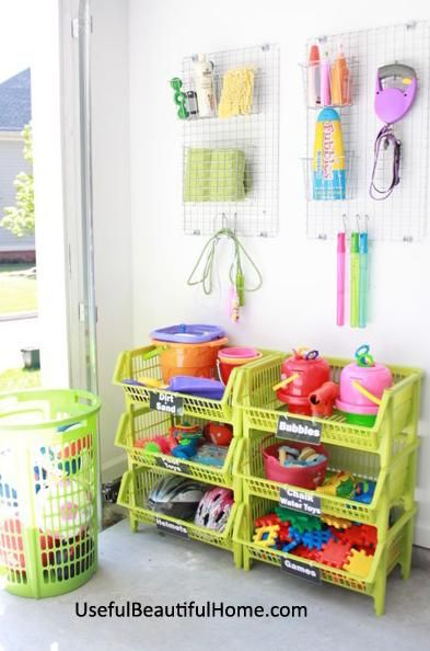 I'm loving the fun colors for this storage space! Create an area for your children's favorite outdoor items by using stackable brightly colored baskets and wall hooks.