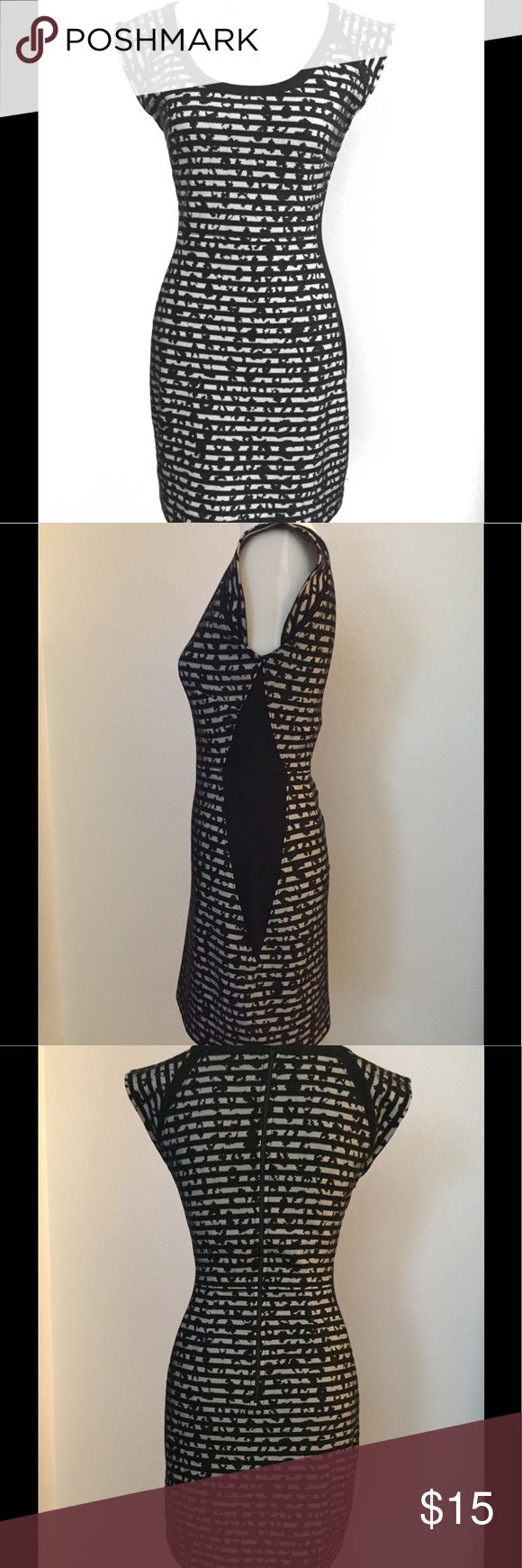 Size 6 French Connection black and white dress Size 6 French Connection black and white bodycon dress, is gently used, no signs of wear. A little over 31 inches long. It is so flattering and well made. The material is thick cotton spandex knit ,black and white stripe pattern with a patterned black mesh sewn to the material. Sides have a black panel which is very slimming. French Connection Dresses Mini