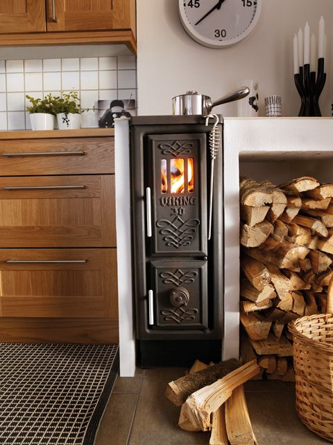 Scandinavian wood stove in a tiny space. What could you do with this? @JoeTHH www.tinyhousehacks.com