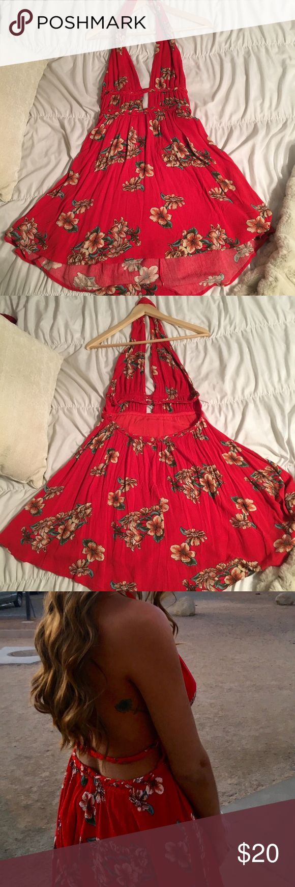 Red dress boutique floral halter dress Gorgeous red dress with floral patterns on it. Halter top with an open back. Only worn once! Dresses