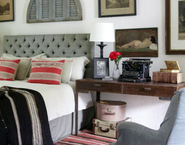 Love the whole look: upholstered headboard, art collage, accents...makes me smile:)