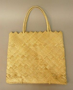 Flat rectangular pandanus-leaf plaited bag / basket, natural ecru colour, plain check, both sides decorated with four horizontal twilled bands; opening with zigzag edge, two handles formed of one continuous strip plaited into body of bag, passing inside and outside under bottom.